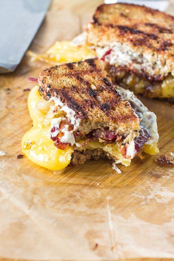 Trainwreck Grilled Cheese   www.oliviascuisine.com   Gouda, caramelized onions and Maple Whiskey bacon join forces to create the most amazing grilled cheese ever! (Sponsored by Arla Dofino)