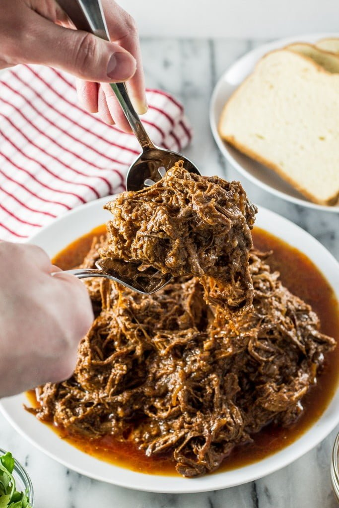 Slow-Cooked Pulled Brisket   www.oliviascuisine.com   Make this delicious pulled brisket in your crockpot and enjoy it in sandwiches, wraps or even in baked potatoes!