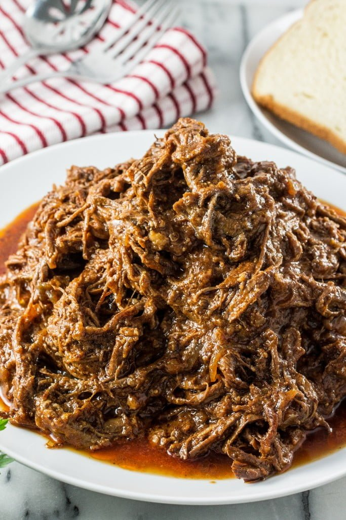 Slow-Cooked Pulled Brisket | www.oliviascuisine.com | Make this delicious pulled brisket in your crockpot and enjoy it in sandwiches, wraps or even in baked potatoes!