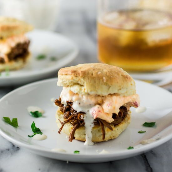 White BBQ Brisket Sandwiches | www.oliviascuisine.com | Eat like a Southerner with these delicious sandwiches made with pulled brisket, white BBQ sauce, pimento cheese in homemade biscuits!