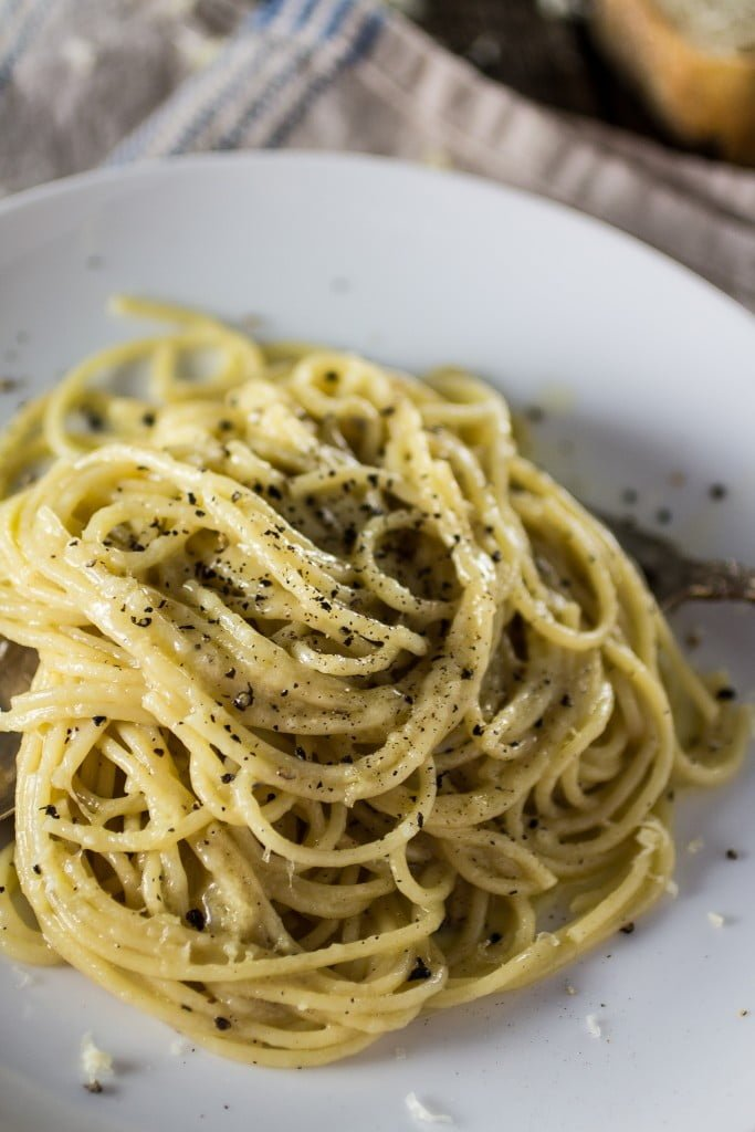 Spaghetti Cacio e Pepe | www.oliviascuisine.com | A traditional roman pasta dish made with Pecorino cheese, Parmigiano Reggiano, black pepper, spaghetti, butter, salt and pepper! And it's done in 20 minutes!