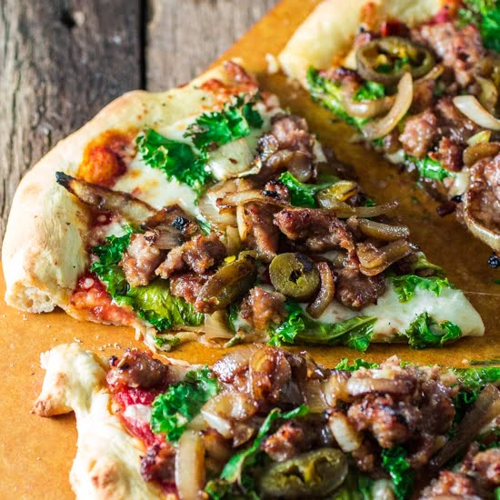 Italian Sausage Pizza with Caramelized Onions, Kale and Jalapeños | www.oliviascuisine.com