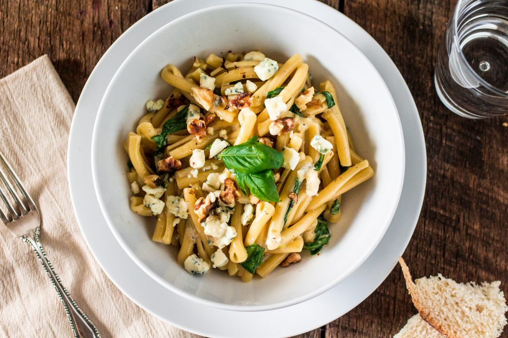 Casarecce Siciliane with Gorgonzola, Walnuts, Arugula and a touch of cream | www.oliviascuisine.com | This Italian dish is easy, hearty and perfect either for busy weeknights or leisurely dinner parties!