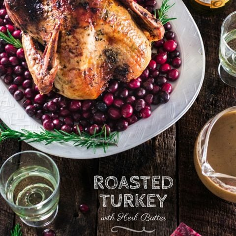 Roasted Turkey with Herb Butter | www.oliviascuisine.com | Looking for a good turkey recipe for Thanksgiving or Christmas? Look no further! This turkey is roasted with a parsley, lemon and garlic butter and covered in bacon (during roasting time) for amazing flavor and juiciness!