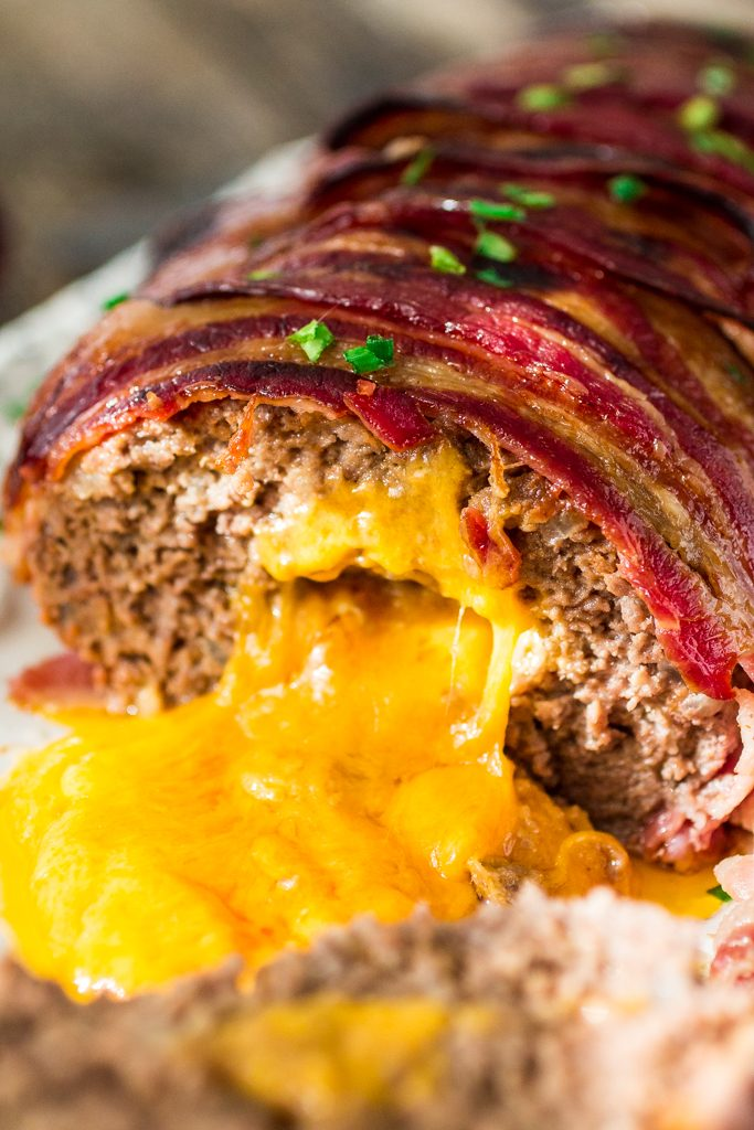 Bacon Wrapped Cheese Stuffed Meatloaf | www.oliviascuisine.com | Forget tough, dry meatloaves! This Bacon Wrapped Cheese Stuffed Meatloaf is not only moist but SO FLAVORFUL! Comfort food at its best! #NaturallyCheesy #AD