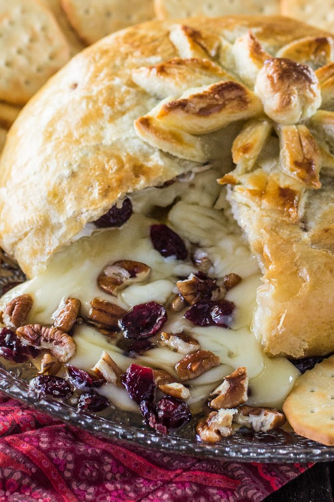 Baked Brie en Croute | www.oliviascuisine.com | A delicious brie cheese covered in puff pastry and filled with honey, cranberries and pecans. Perfect as a Thanksgiving or Christmas appetizer!