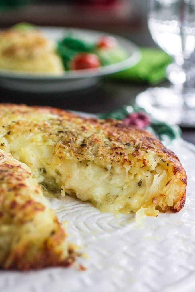 Three-Cheese Stuffed Rosti Potatoes | www.oliviascuisine.com | This delicious dish comes from Switzerland and consists of a potato cake, fried on both sides and stuffed with 3 different types of cheese. Perfect as a side dish for the holidays or as a main course whenever you are craving potatoes. #BeholdPotatoes #sponsored