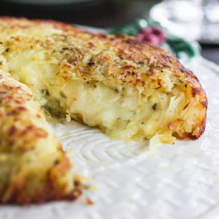 Three-Cheese Stuffed Rosti Potatoes   www.oliviascuisine.com   This delicious dish comes from Switzerland and consists of a potato cake, fried on both sides and stuffed with 3 different types of cheese. Perfect as a side dish for the holidays or as a main course whenever you are craving potatoes. #BeholdPotatoes #sponsored