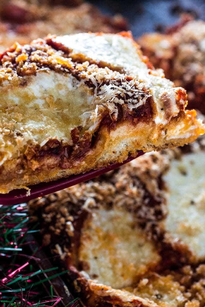 Sfincione (Sicilian Christmas Pizza) | www.oliviascuisine.com | This deep-dish pizza is topped with caramelized onions, breadcrumbs and caciocavallo. It is usually served for Christmas Eve or New Year's Eve in Sicily, but available all year long. #sponsored