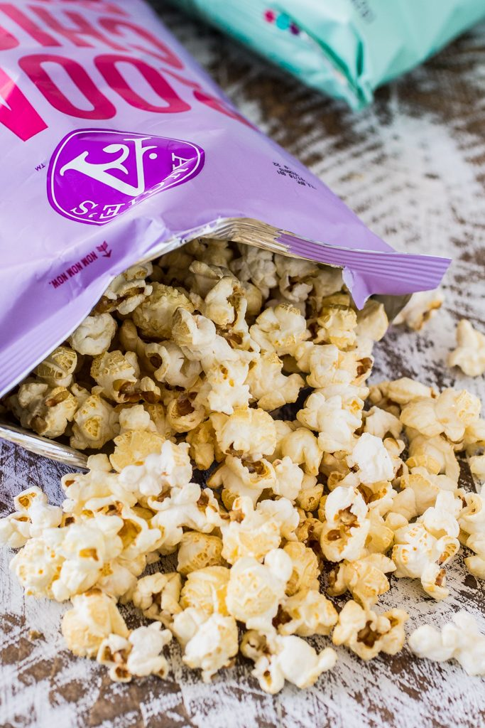 Popcorn Party Mix | www.oliviascuisine.com | Making a popcorn party mix couldn't be easier. Simply toss together some BOOMCHICKAPOP, chocolate covered pretzels and roasted almonds. Oh, and don't forget to drizzle everything with some melted peanut butter! :P #sponsored #BringtheBOOM