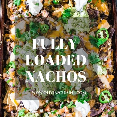 Fully Loaded Nachos | www.oliviascuisine.com | 9 layers of perfection: 3 different kinds of tortilla chips, Chipotle Beer Shredded Beef, Black Beans, the most incredible cheese sauce, more cheese, pico de gallo salsa, jalapeños, guacamole and sour cream or mexican crema!