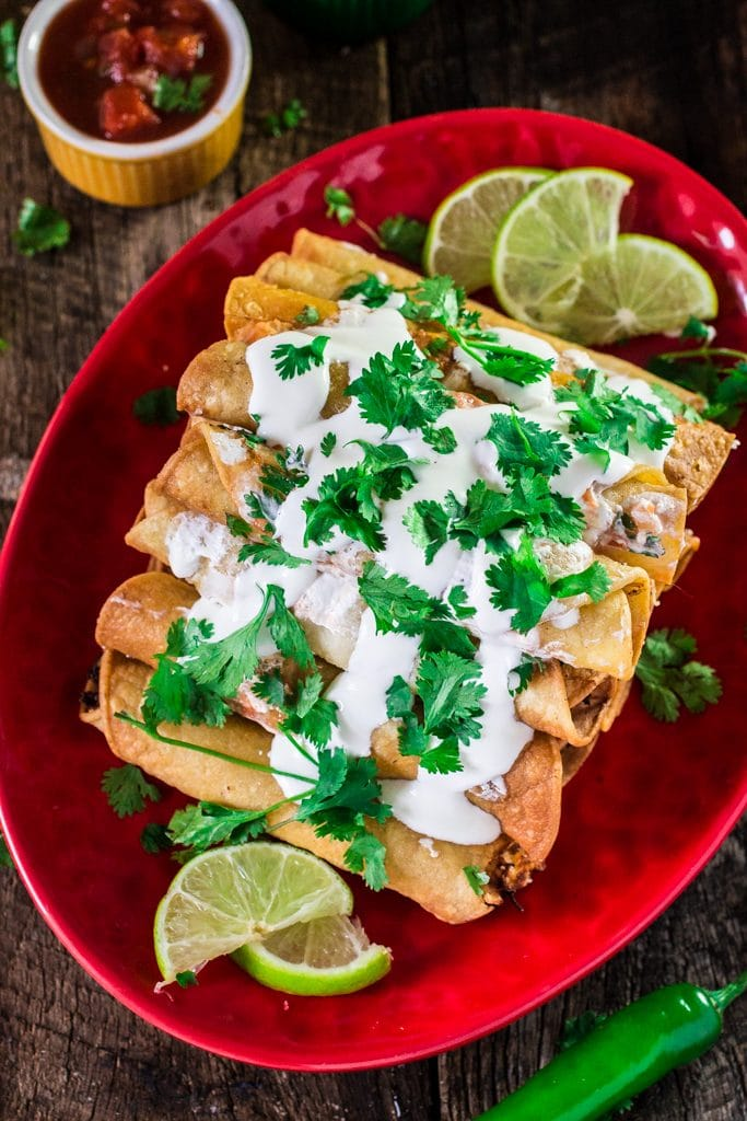 Creamy Chicken Taquitos with Salsa Roja   www.oliviascuisine.com   These chicken taquitos - or flautas, in Spanish - are seriously to die for! Crunchy, creamy and bursting with shredded chicken! The kids will definitely love it ! #sp #DiaDelNino #HerdezKids