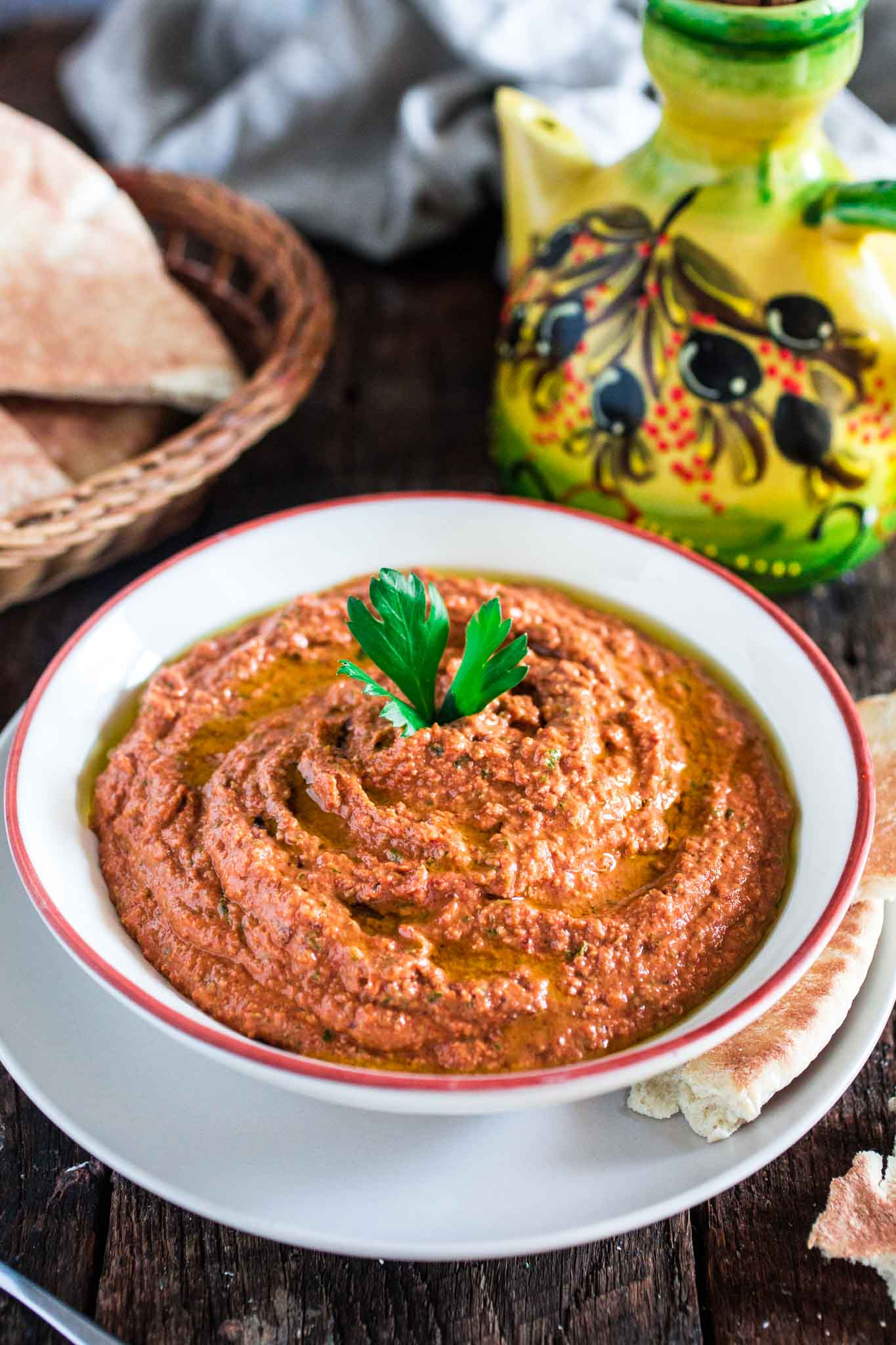 Muhammara (Red Pepper and Walnut Dip)   www.oliviascuisine.com   A middle eastern spread made with roasted red peppers, toasted walnuts, scallions, spices, breadcrumbs, olive oil and pomegranate molasses. It's a delicious sweet and spicy dip and a great alternative to hummus! (In partnership with Mezzetta.)
