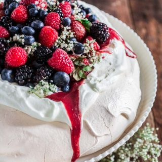 Berry Pavlova | www.oliviascuisine.com | A delicious meringue-based dessert named after the Russian ballerina Anna Pavlova. Easy to make and always a crowd pleaser!