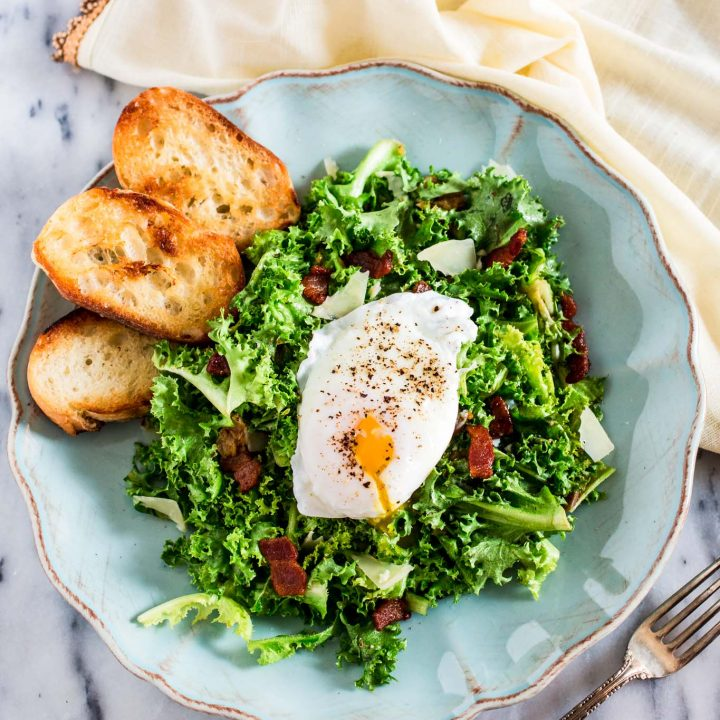 Lyonnaise Salad | www.oliviascuisine.com | This classic French salad, from Lyon, is made with frisée lettuce, bacon, a delicious shallot mustard vinaigrette and a poached egg.