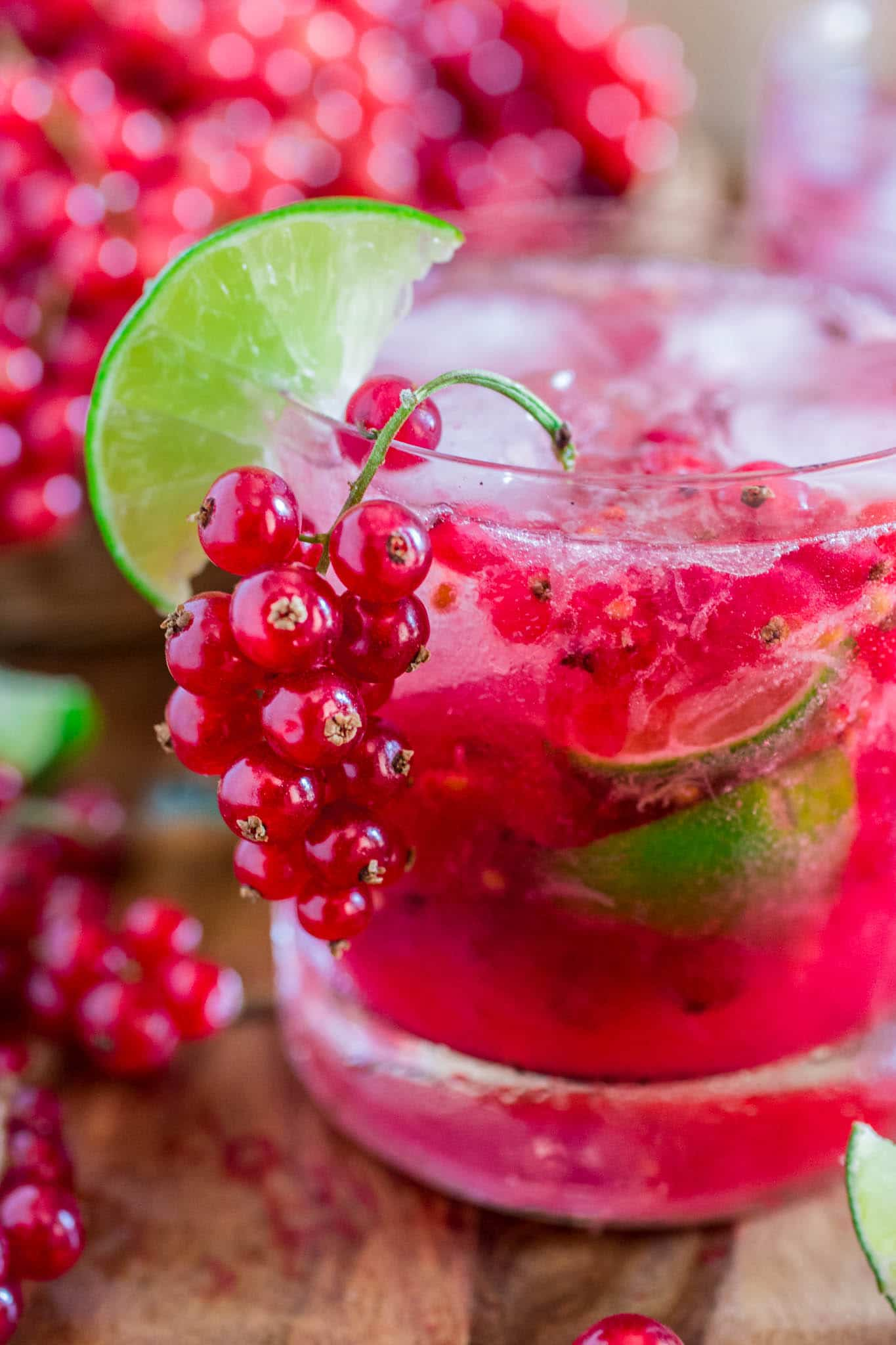 Red Currant Caipirinha | www.oliviascuisine.com | This red currant twist on a classic lime Caipirinha might be my new favorite summertime cocktail! Sour, sweet and as strong as you can take it. There's really no better way to beat the heat! (Sponsored by HBF International.)