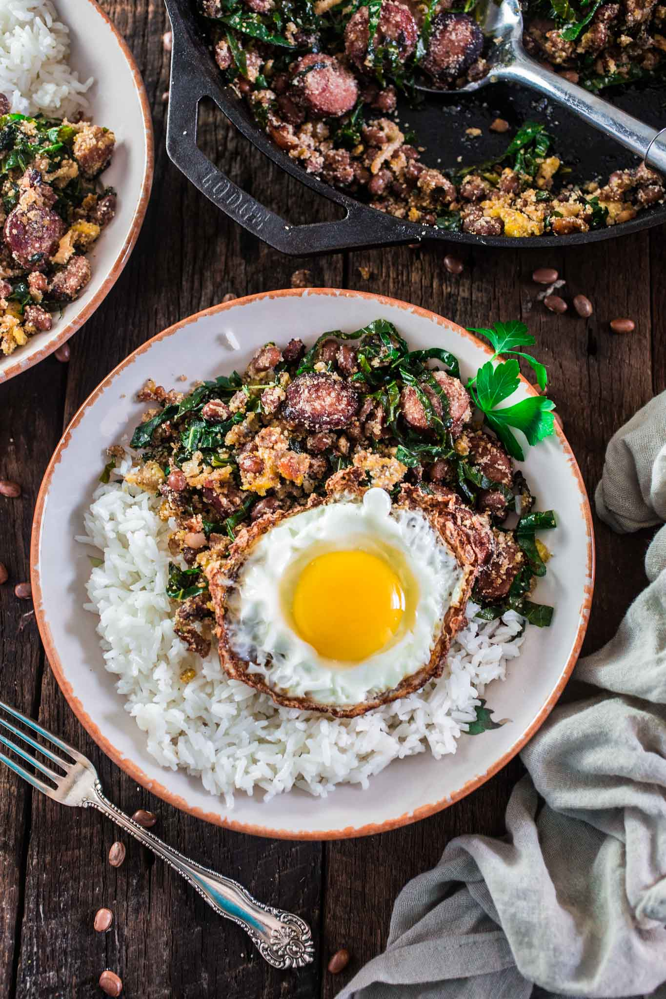 Feijão Tropeiro (Brazilian Beans with Sausage and Collard Greens) | www.oliviascuisine.com | If you like Brazilian food, this one is for you: Feijão Tropeiro. A traditional dish from Minas Gerais, made with beans, bacon, sausage, collard greens, eggs and manioc flour.