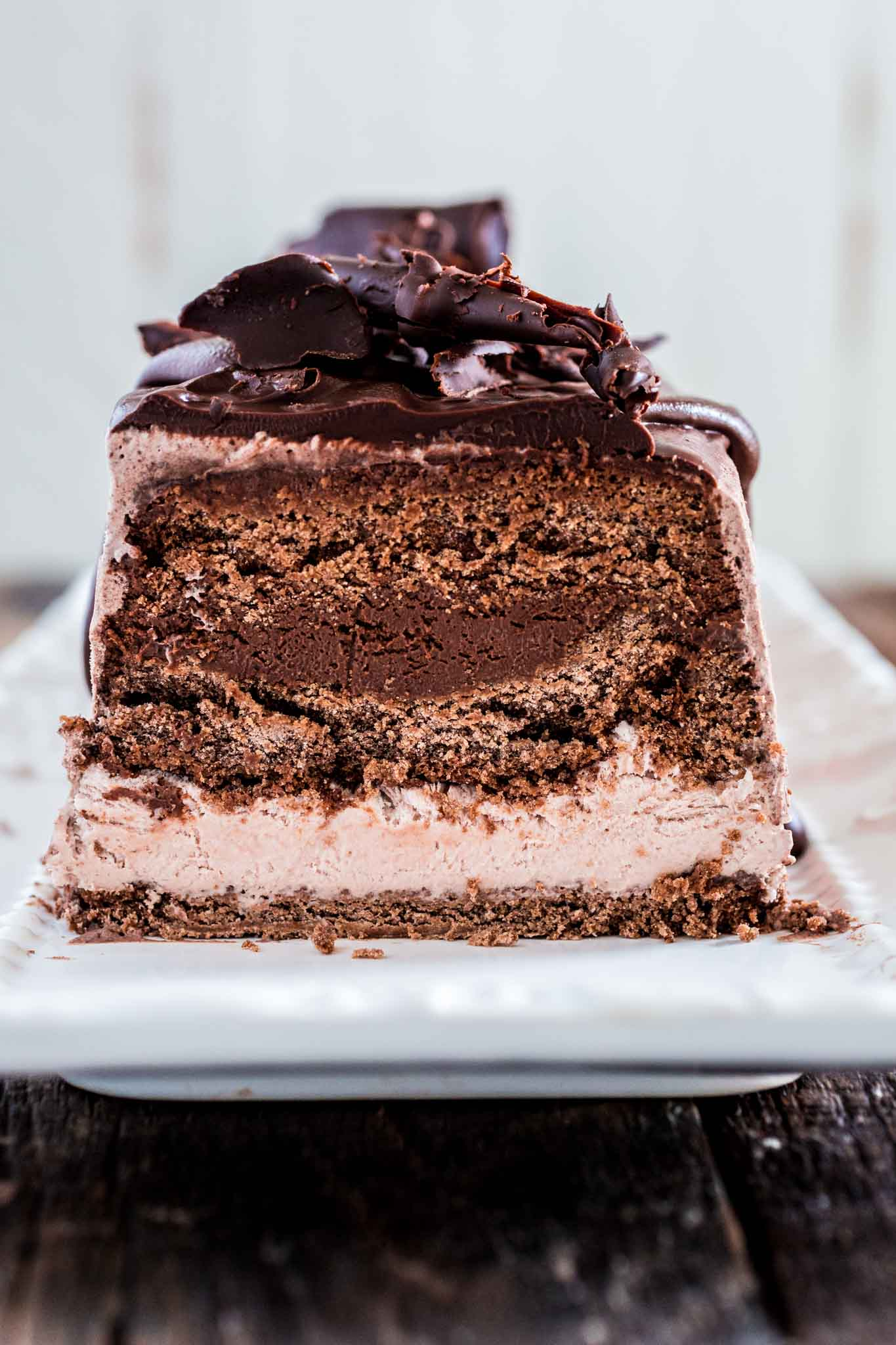 Chocolate Ice Cream Cake | www.oliviascuisine.com | This make-ahead chocolate ice cream cake has everything a chocoholic desires: chocolate cake, chocolate mousse and chocolate ice cream. It is a delightful dessert to celebrate a birthday or end a fabulous dinner party! (Sponsored by @CuriousCreamery) #CuriousCreamery #ad