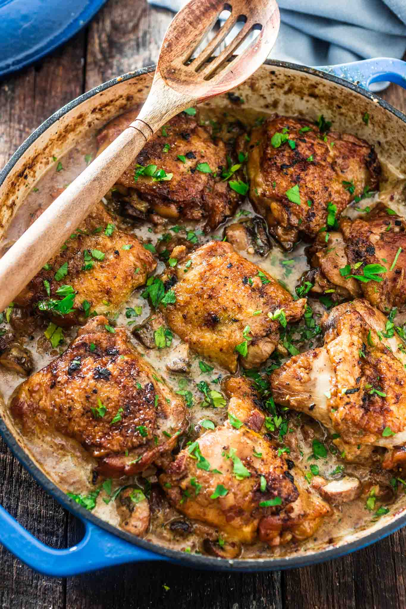 Coq au Riesling (Chicken Thighs Braised in White Wine) | www.oliviascuisine.com | A creamy twist on the classic Coq au Vin. Chicken thighs, bacon and mushrooms are braised in an off-dry Riesling and heavy cream is added at the end to make it even more delicious! Oh, and it's all made in one pot! (Sponsored by @theseekerwines)