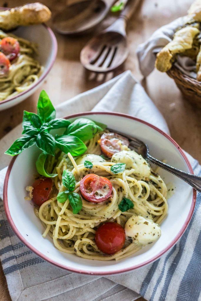 "Spaghetti with Pesto Cream Sauce, Fresh Tomatoes and Mozzarella | www.oliviascuisine.com | Who can say ""no"" to spaghetti tossed in a delicious pesto cream sauce topped with fresh cherry tomatoes and mozzarella balls? Not me! Especially when it's so easy to make and on the table in 15 minutes!"