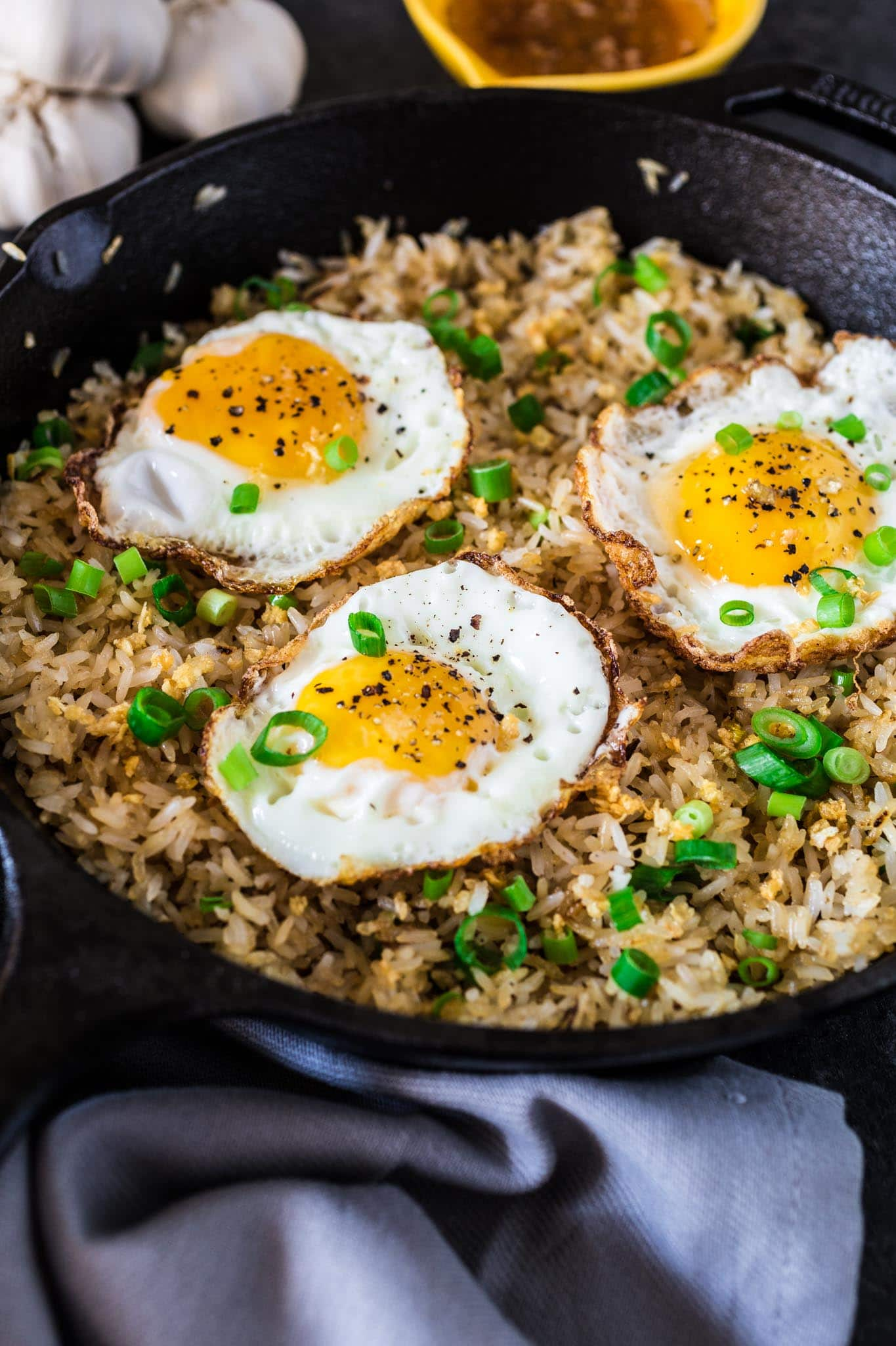 Filipino Garlic Fried Rice | www.oliviascuisine.com | Sinangag, or Garlic Fried Rice, is a popular Filipino breakfast, often served with a fried egg on top and a drizzle of vinegar sauce. Don't have a stomach for rice and garlic in the morning? No problem! This dish is also amazing for lunch or as a side for dinner.