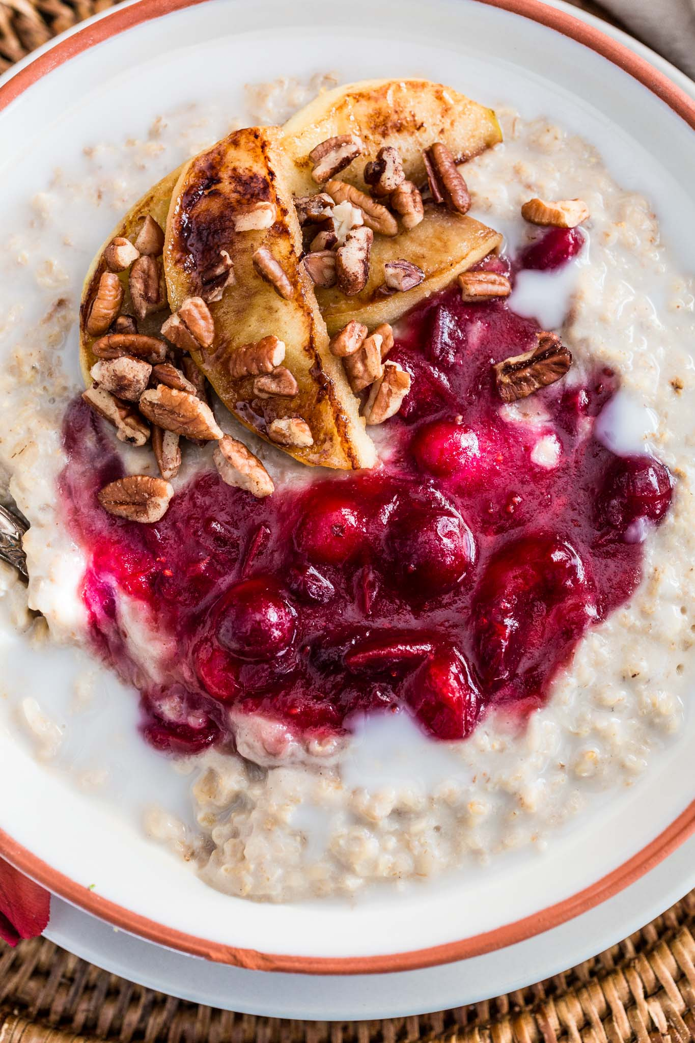 Christmas Oats Porridge with Cranberry Sauce, Apples and Pecans | www.oliviascuisine.com | Waking up to a special breakfast on Christmas morning is a must! This festive porridge is not only delicious but also heartwarming. Sweet, tart, creamy and crunchy goodness. What else could we wish for?