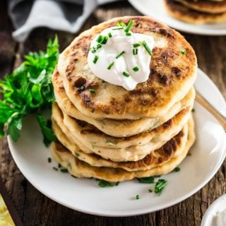 """Mashed Potato Pancakes   www.oliviascuisine.com   Crisp and tender buttery Mashed Potato Pancakes are the perfect start for your Thanksgiving holiday! Made with just a few basic ingredients and ready in less than 20 minutes. Because """"delicious yet easy"""" is my holiday motto!"""