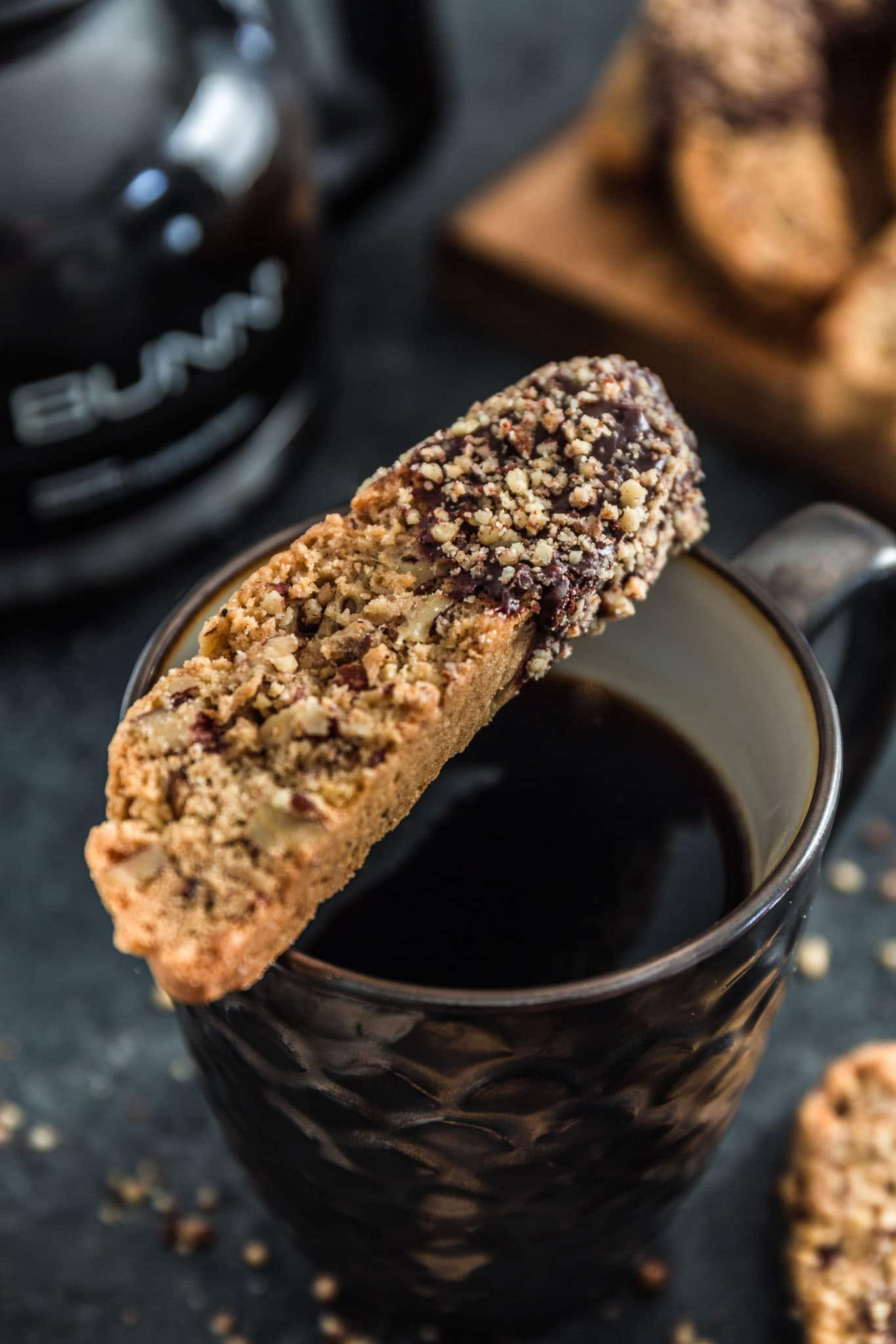 Chocolate Dipped Cinnamon Pecan Biscotti | www.oliviascuisine.com | Lighter than Italian biscotti, these Chocolate Dipped Cinnamon Pecan Biscotti are crisp, tender and filled with some of my favorite holiday noms: cinnamon, pecan and chocolate! Perfect to give out as holiday gifts or just to dunk into your coffee.