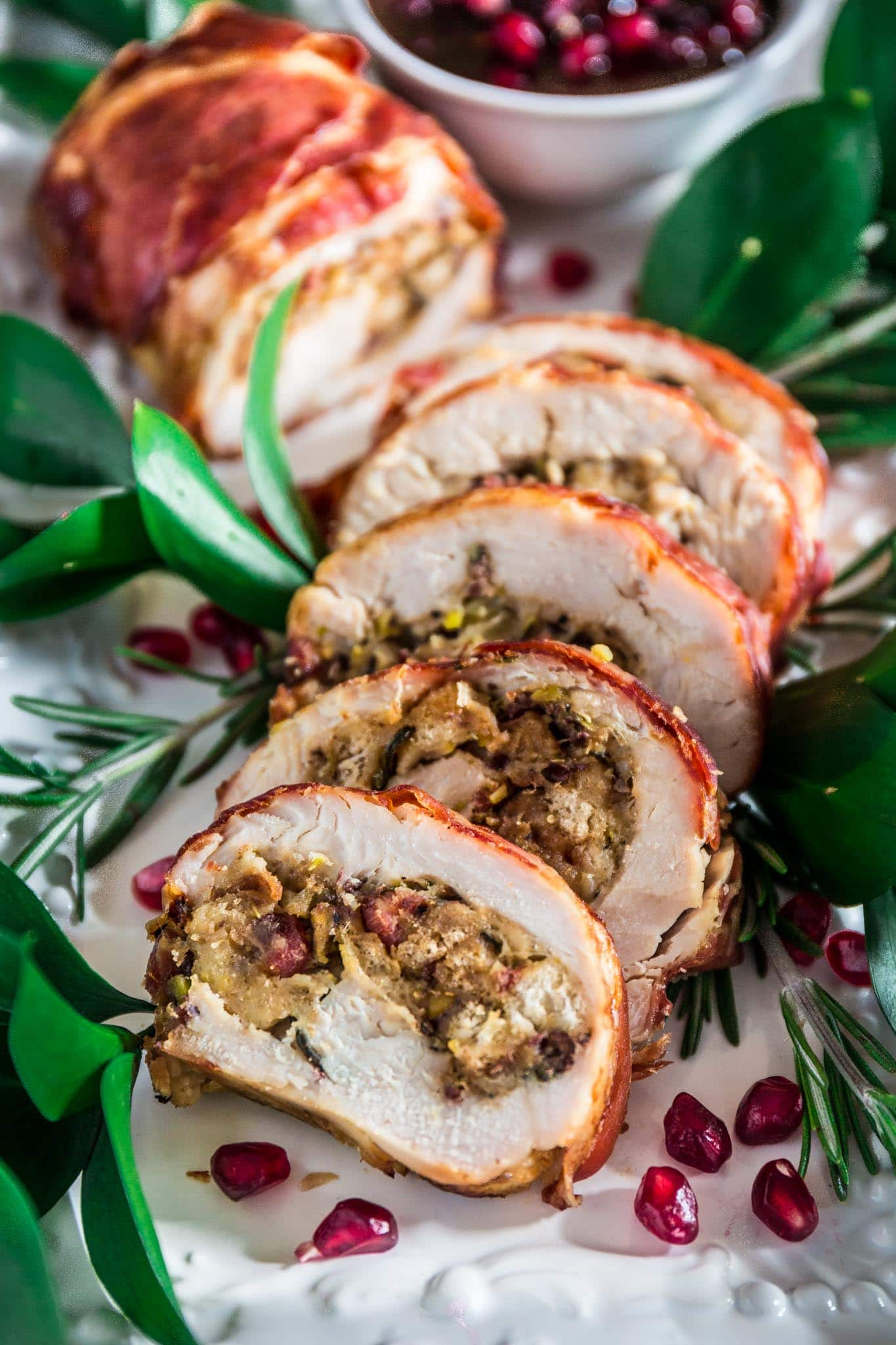 Prosciutto Wrapped Turkey Roulade with Pomegranate-Port Reduction Sauce   www.oliviascuisine.com   No time to roast a whole turkey? Knock the socks off your guests with this simple and quick to assemble turkey roulade. Moist, stuffed with pancetta, pistachio and cranberries, wrapped in Prosciutto di Parma and served with a lip-smacking pomegranate port reduction sauce. One bite and the holidays will never be the same again!