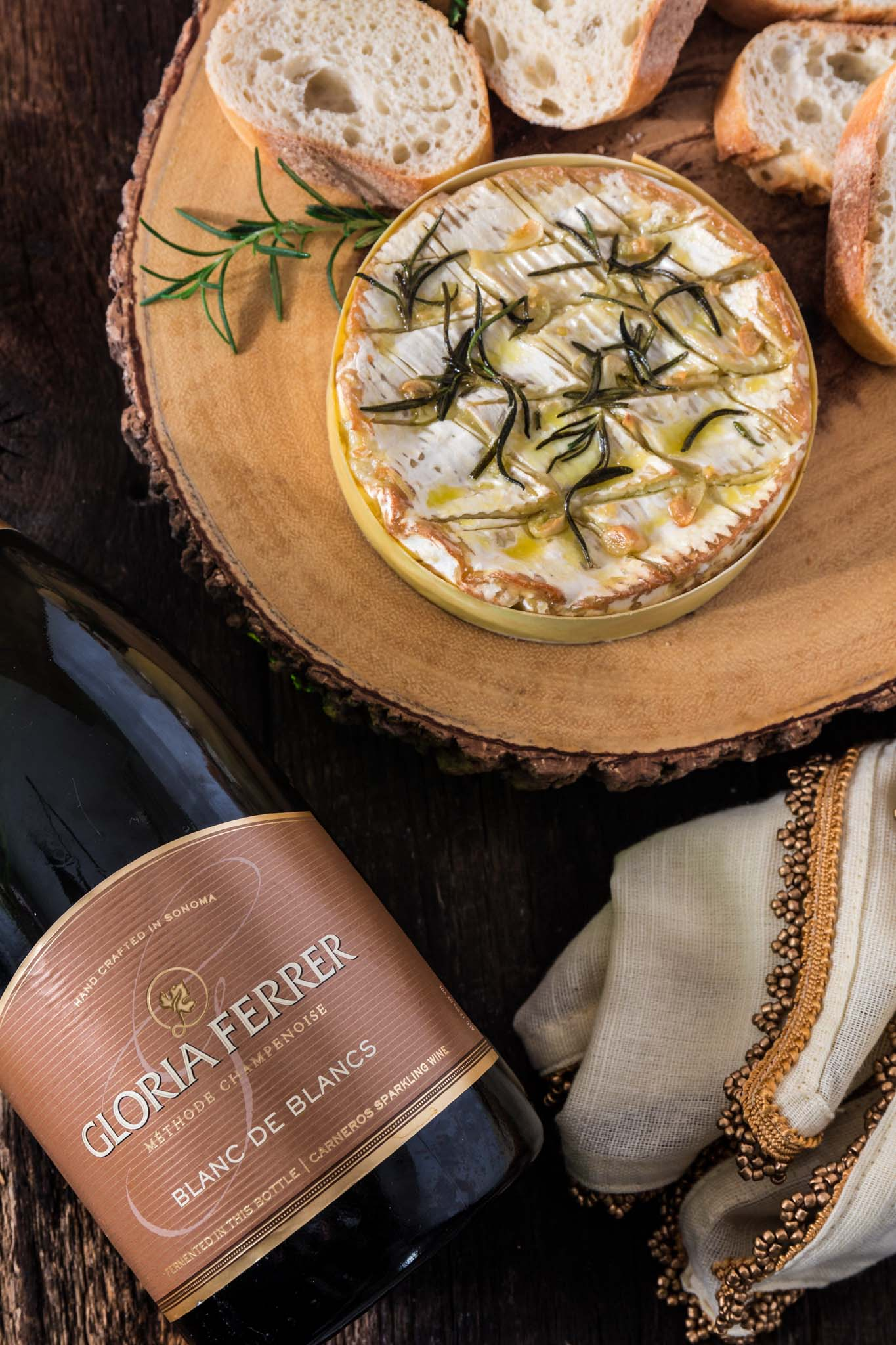 Baked Camembert with Garlic and Rosemary | www.oliviascuisine.com | A gooey and fragrant Baked Camembert is always a must at my dinner parties. This version with garlic and rosemary is one of my favorites and pairs greatly with a glass of bubbly!