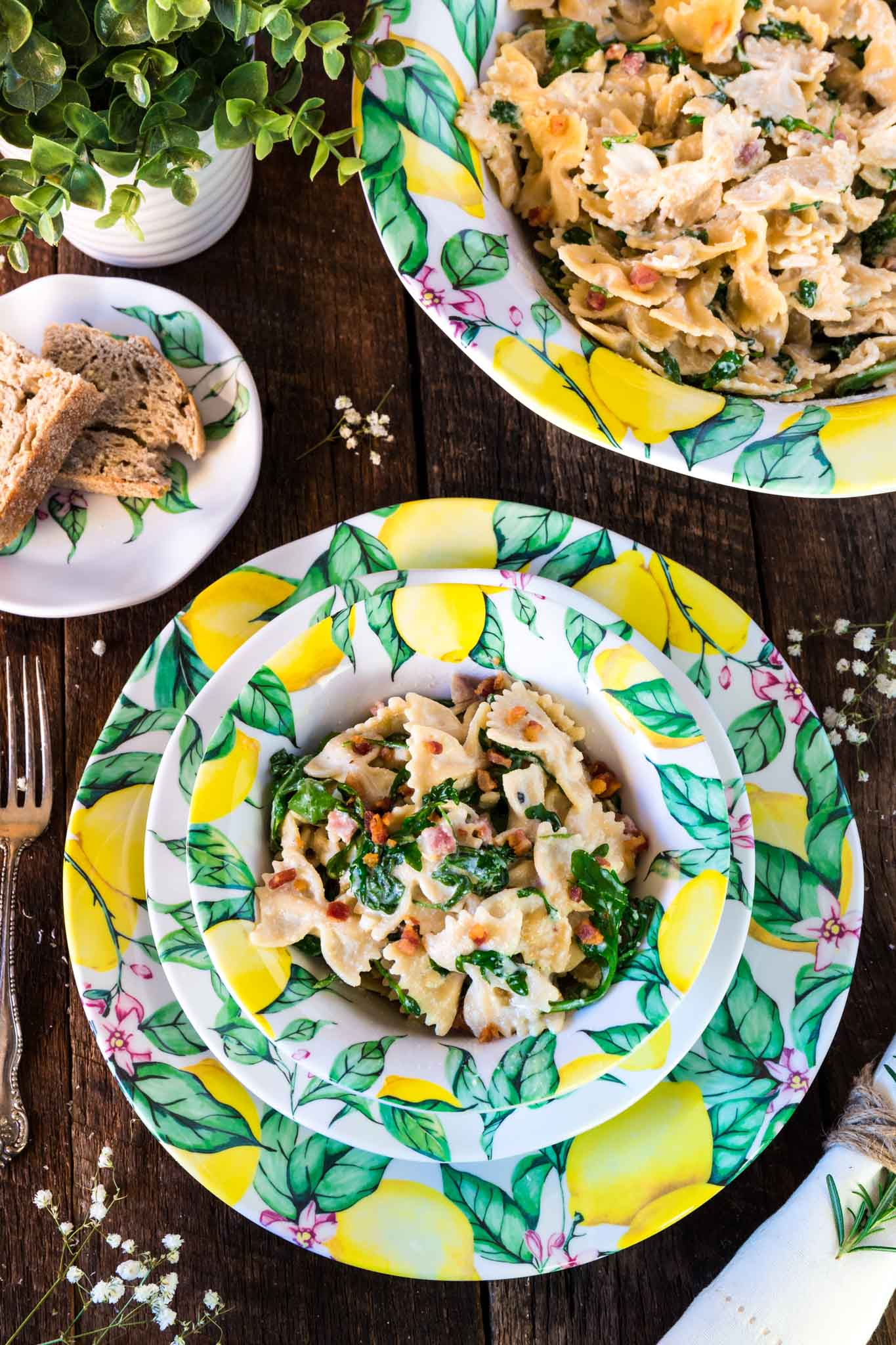 Farfalle with Pancetta, Arugula and Lemon Cream Sauce | www.oliviascuisine.com | A pasta dish that embodies all the things we love about spring and summer. Fresh, colorful and tied together with a lip smacking lemon cream sauce that is to die for! Featuring the beautiful Q Squared NYC's Limonata Collection. (Recipe by @oliviascuisine.)