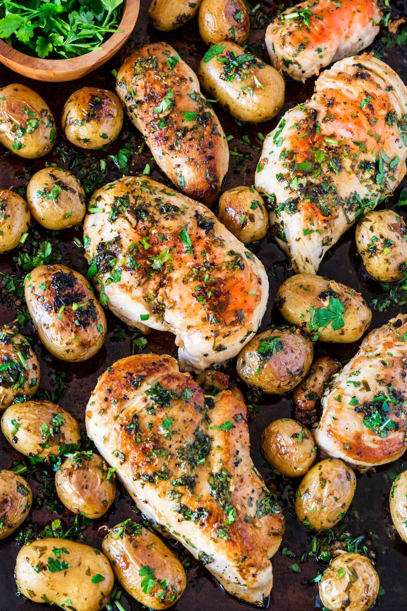 Sheet Pan Chicken with Spicy Potatoes (Batata Harra) | www.oliviascuisine.com | The easiest meal ever consists of juicy and perfectly seasoned chicken breasts served with batata harra, baked Lebanese spicy potatoes that melt in your mouth while enticing your tastebuds. (Recipe by @oliviascuisine.)