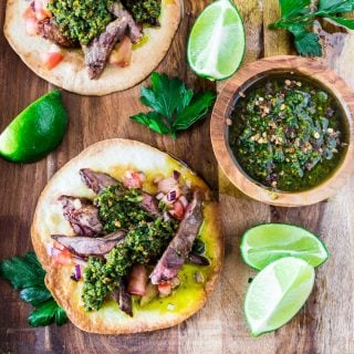 Carne Asada Tostadas with Pistachio Chimichurri | www.oliviascuisine.com | Get in the mood for Cinco de Mayo with these Carne Asada Tostadas served with a delicious pistachio chimichurri sauce. Crunchy, juicy, nutty and beyond irresistible! Trust me, you'll be hooked. (Recipe by @oliviascuisine.)