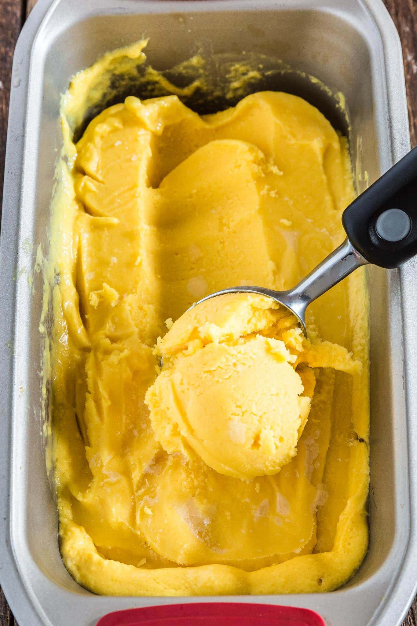 Mango Frozen Yogurt | www.oliviascuisine.com | Luscious, creamy and tangy, this Mango Frozen Yogurt is everything you need on a hot summer day! And the best part? No ice cream machine necessary! (Recipe by @oliviascuisine.)