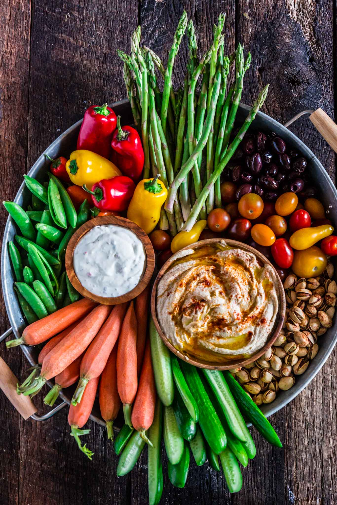How to Assemble a Crudité Platter | www.oliviascuisine.com | Learn how to set up a Crudité Platter that your guests will actually enjoy, filled with fresh and seasonal veggies and a few delicious dips, olives and nuts. Follow this quick guide and I guarantee you will find even the pickiest of eaters hanging around this awesome vegetable tray! (Recipe and photos by @oliviascuisine)