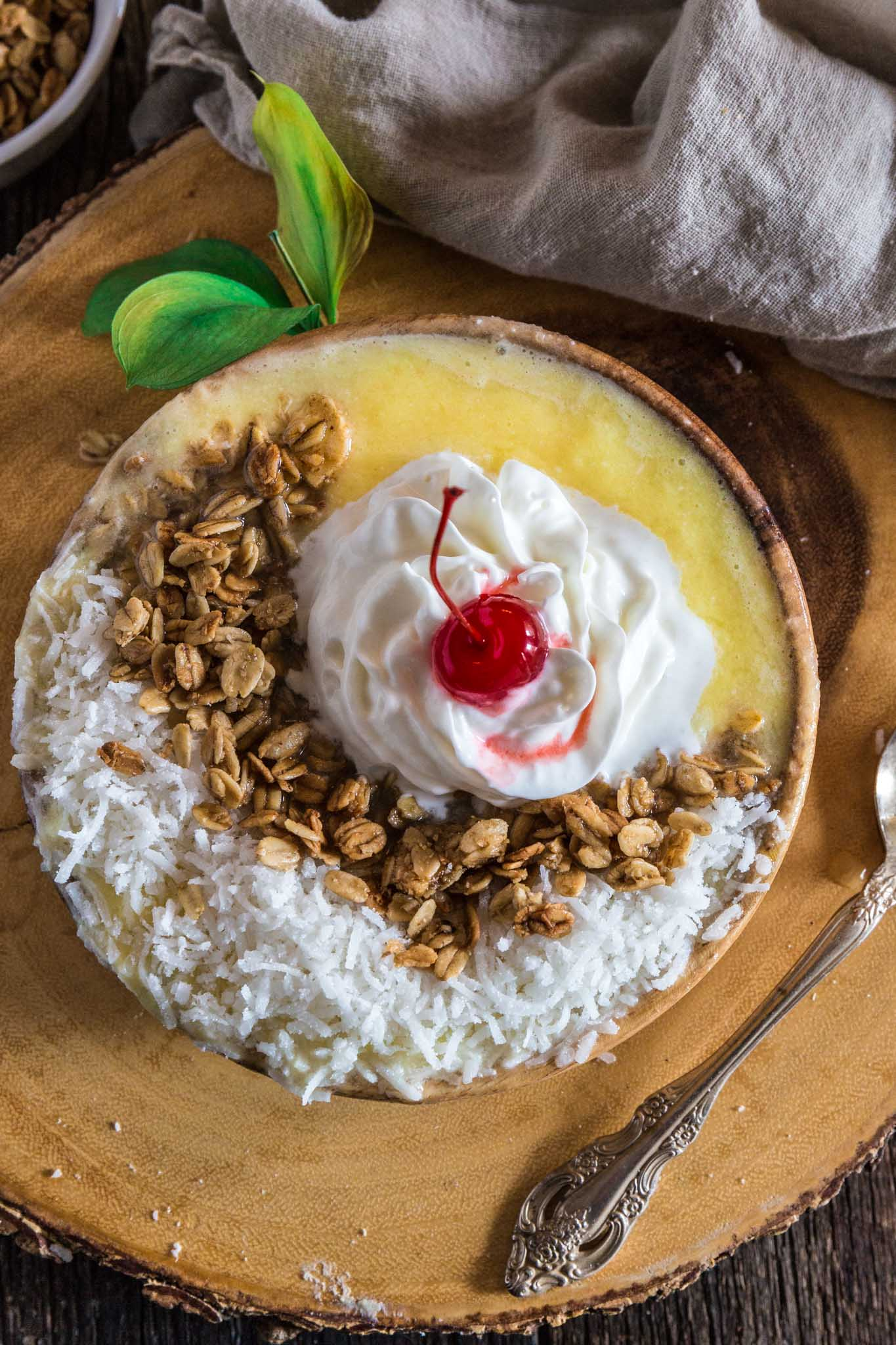Pina Colada Smoothie Bowl   www.oliviascuisine.com   Can't escape to a beach somewhere at the moment? No problem! Make this Pina Colada Smoothie Bowl and you'll feel like you're in a tropical paradise. (Recipe and food photography by @oliviascuisine.)