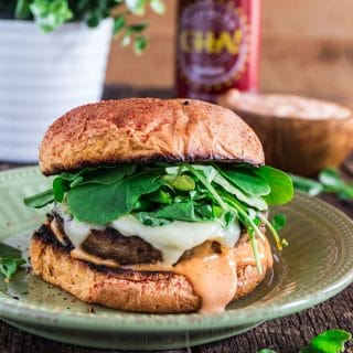 Sriracha Turkey Burger | www.oliviascuisine.com | A juicy Sriracha turkey burger topped with spicy and creamy Sriracha mayo, Swiss cheese and watercress! Who could resist that?