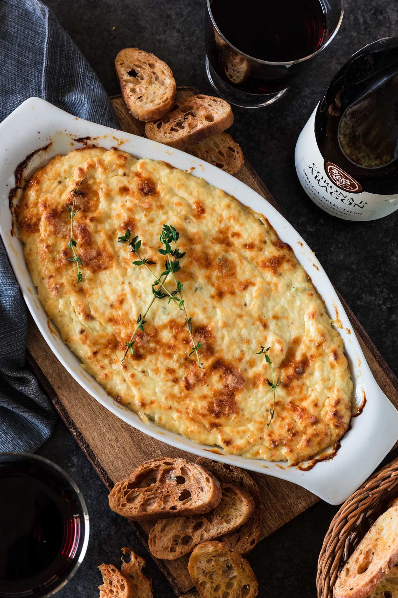 Roasted Garlic Baked Ricotta | www.oliviascuisine.com | Simple, yes. Mediocre? Never! This hot, cheesy and garlicky dip is all you'd want in an appetizer. Make it this holiday season, serve with some good wine and get ready to be called The Entertaining Queen/King. (Recipe and food photography by @oliviascuisine.)