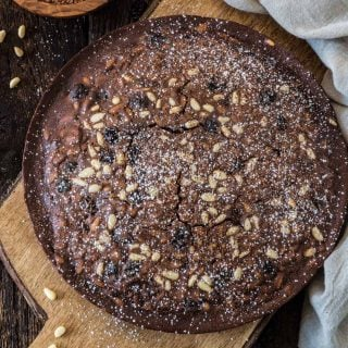 Castagnaccio Pugliese (Chestnut Flour Cake) | www.oliviascuisine.com | An Italian autumnal classic, the Castagnaccio is a gluten-free cake made of chestnut flour, olive oil, dried fruits and nuts. Served with a cup of espresso (or wine) and a drizzle of honey, it is the perfect treat on a cold afternoon.