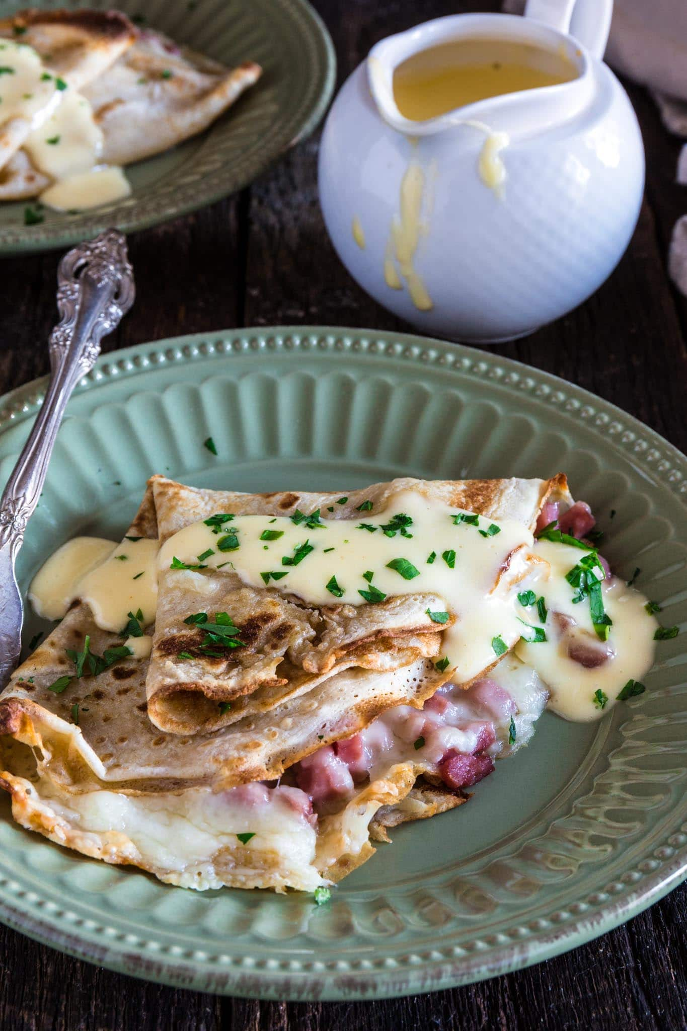 Ham and Cheese Savory Crepes with Hollandaise Sauce | www.oliviascuisine.com | These Ham and Cheese Savory Crepes are beyond fantastic, easy to make and will take breakfast (or brunch) to a whole new level. #AD