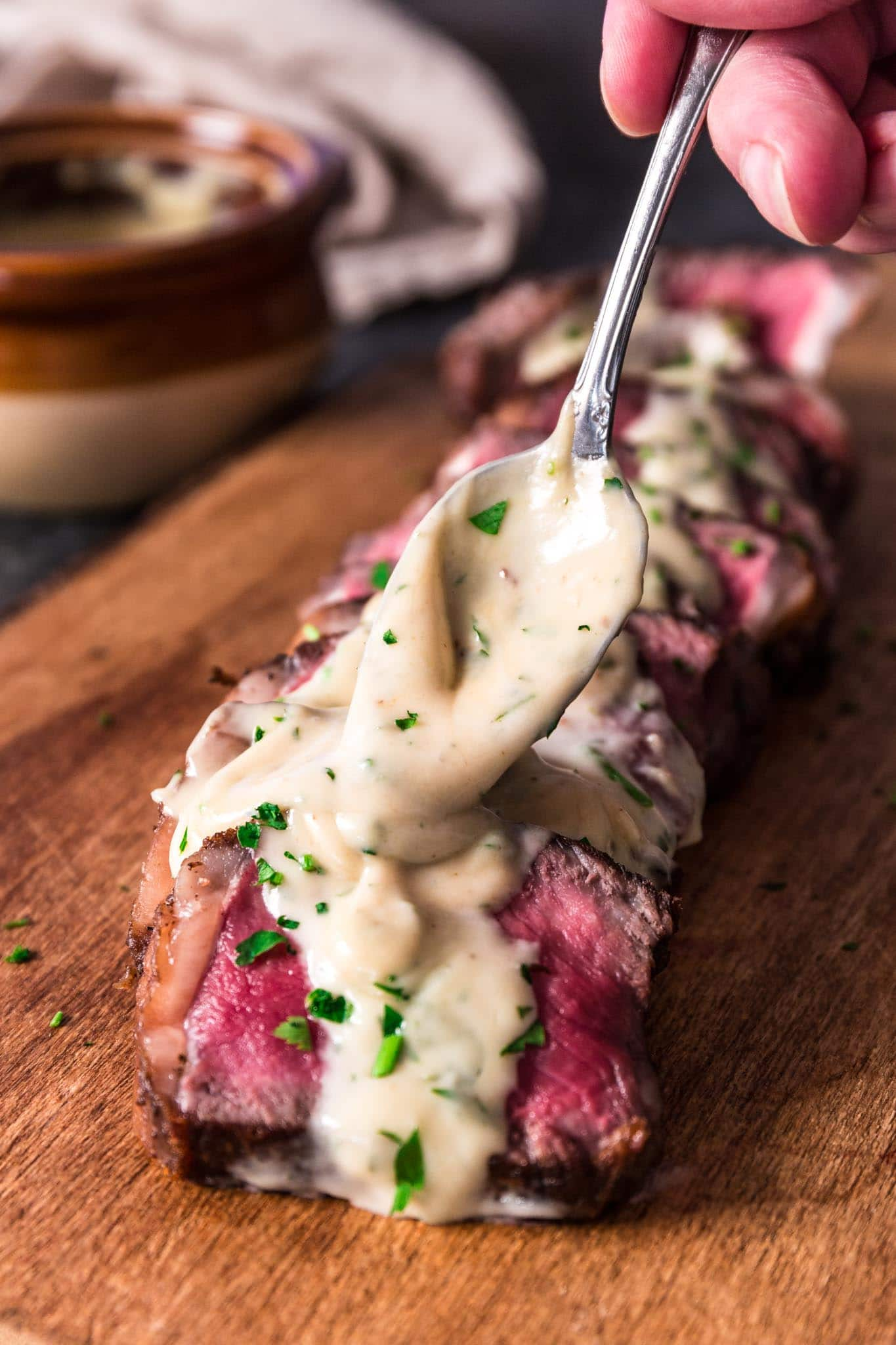 Pan Seared New York Strip Steak with Gorgonzola Sauce | www.oliviascuisine.com | No need to go to a steakhouse to enjoy a juicy New York Strip Steak, cooked to perfection. Follow my tips and you can make a superb steak dinner right at home, on your stove, in less than 30 minutes! The buttery Gorgonzola Cream Sauce is optional, but you'd be crazy to skip it. (Recipe and food photography by @oliviascuisine.)