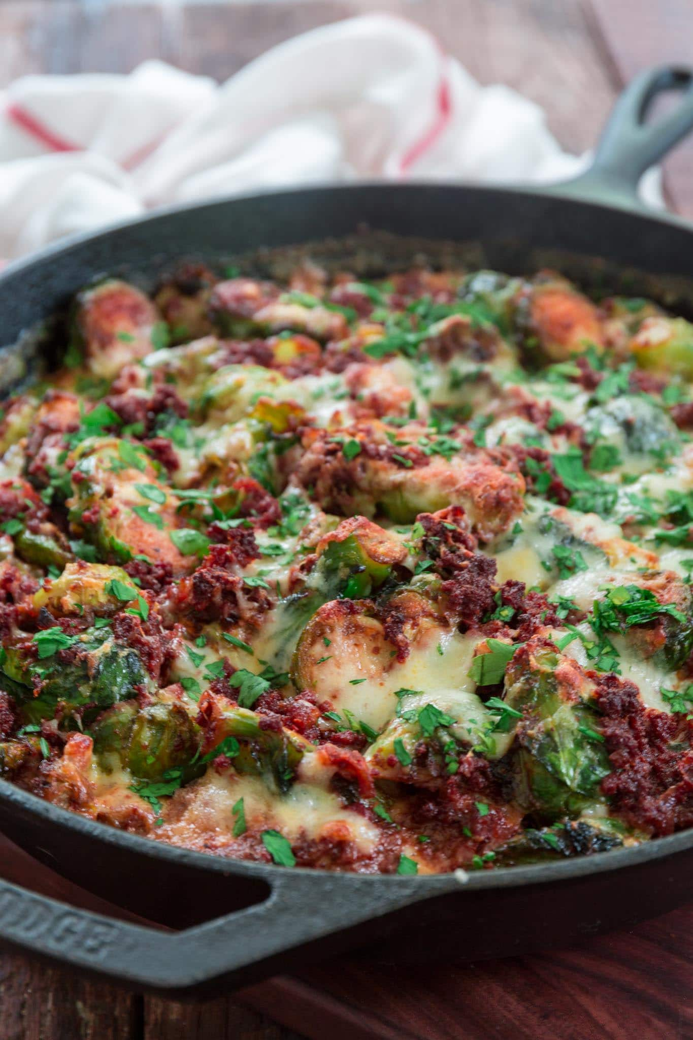 Cheesy Brussels Sprouts with Chorizo | www.oliviascuisine.com | Even the pickiest eaters will love these cheesy Brussels sprouts, caramelized to perfection and topped with spicy chorizo and a whole lot of Manchego cheese. Believe me, those nasty boiled Brussels sprouts that you used to eat as a child have nothing on this unbelievably delicious gourmet side dish! (Recipe and food photography by @oliviascuisine.)