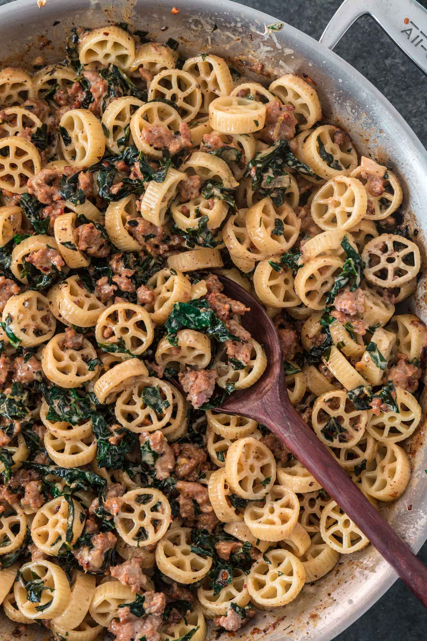 Creamy Sausage Kale Pasta | www.oliviascuisine.com | Possibly my favorite pasta dish, this Creamy Sausage Kale Pasta combines Italian sausage with rich and earthy Tuscan Kale. Tossed in the creamiest lemon parmesan sauce! And you can make it as mild or as spicy as you like! (Recipe and food photography by @oliviascuisine.)