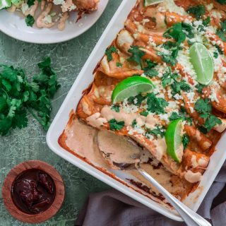 Chicken and Chorizo Enchiladas with Chipotle Crema Sauce | www.oliviascuisine.com | If you like it hot, these Chicken and Chorizo Enchiladas are for you! Spicy, delicious, and smothered with the creamiest Chipotle Crema Sauce. They will knock your socks off! (Recipe and food photography by @oliviascuisine.)