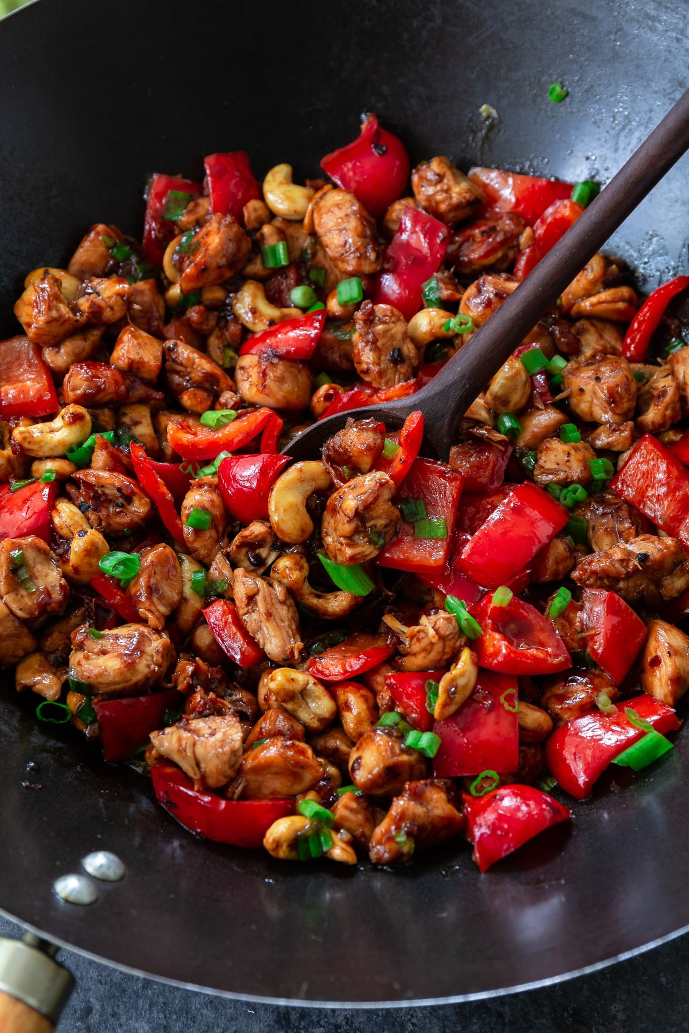 Meal Prep Cashew Chicken | www.oliviascuisine.com | Who needs takeout when you can cook delicious Cashew Chicken at home? Tender chicken, scallions and peppers coated in a rich, sweet sauce and topped with crunchy cashews. I can't get enough of it! (Recipe and food photography by @oliviascuisine.)