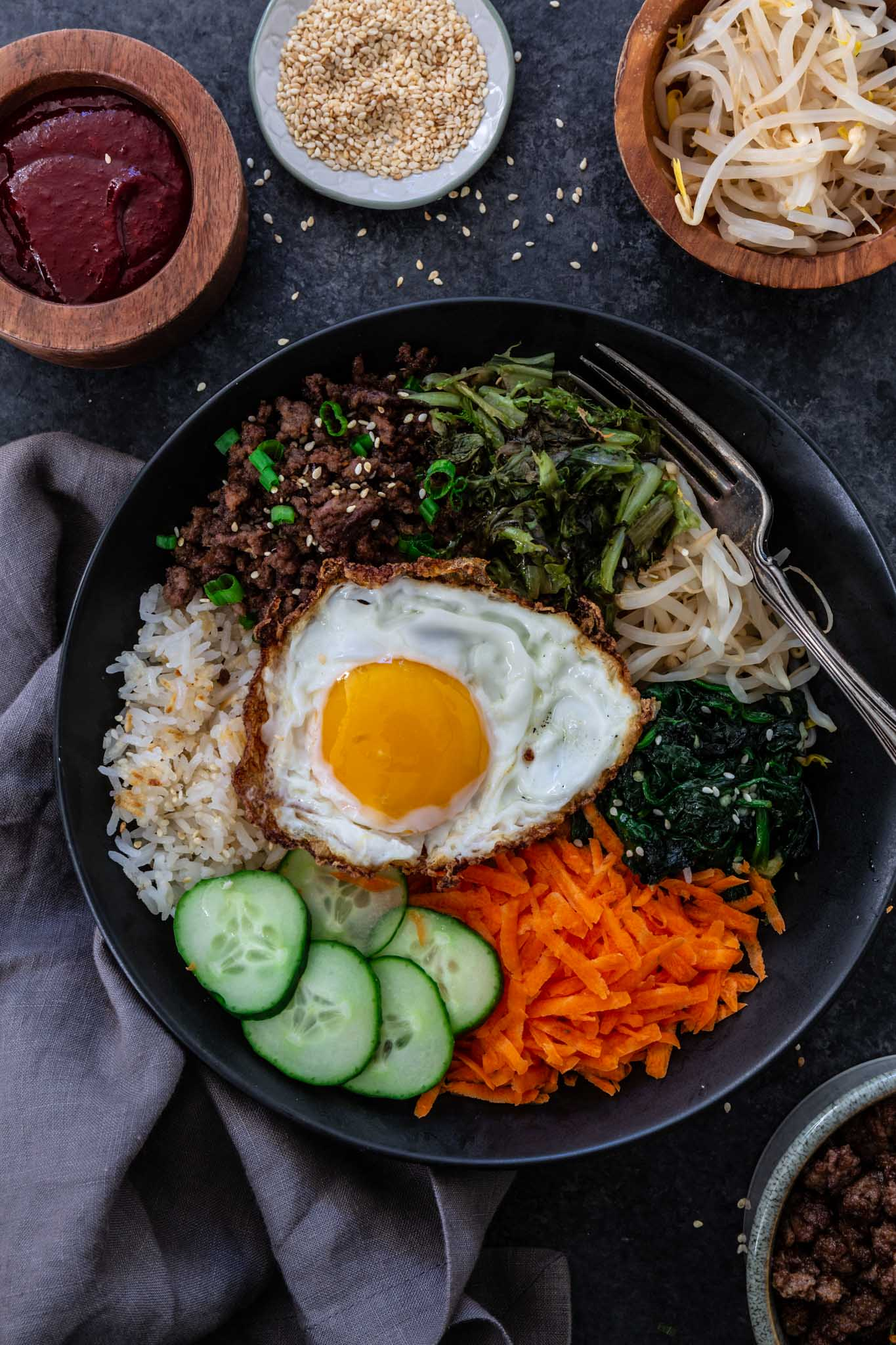 Bibimbap (Korean Beef Rice Bowl)   www.oliviascuisine.com   My version of Bibimbap, a popular Korean rice dish, takes a few shortcuts for convenience! The good news is that it's done in less than 30 minutes without compromising flavor. Serve with a fried egg on top for that extra wow factor! (Recipe and food photography by @oliviascuisine.)
