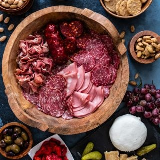 How to Make a Charcuterie Board | www.oliviascuisine.com | Every party deserves a classy and elegant charcuterie board! Carefully curated meats, cheeses and spreads are a great way to feed a crowd. Add some Blue Diamond® Gourmet Almonds and Blue Diamond® Almond Nut-Thins® and you're all set for success! (Recipe and food photography by @oliviascuisine.)