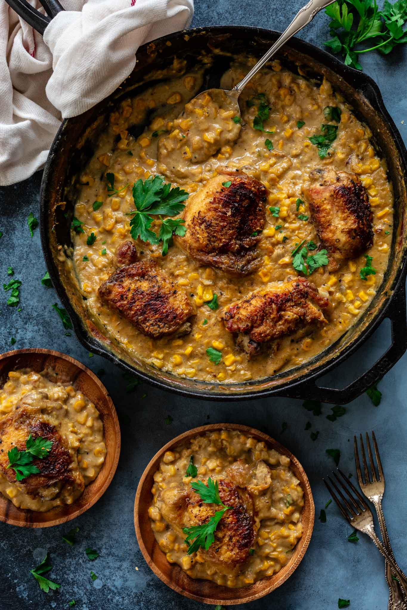Chicken Thighs and Creamed Corn being served