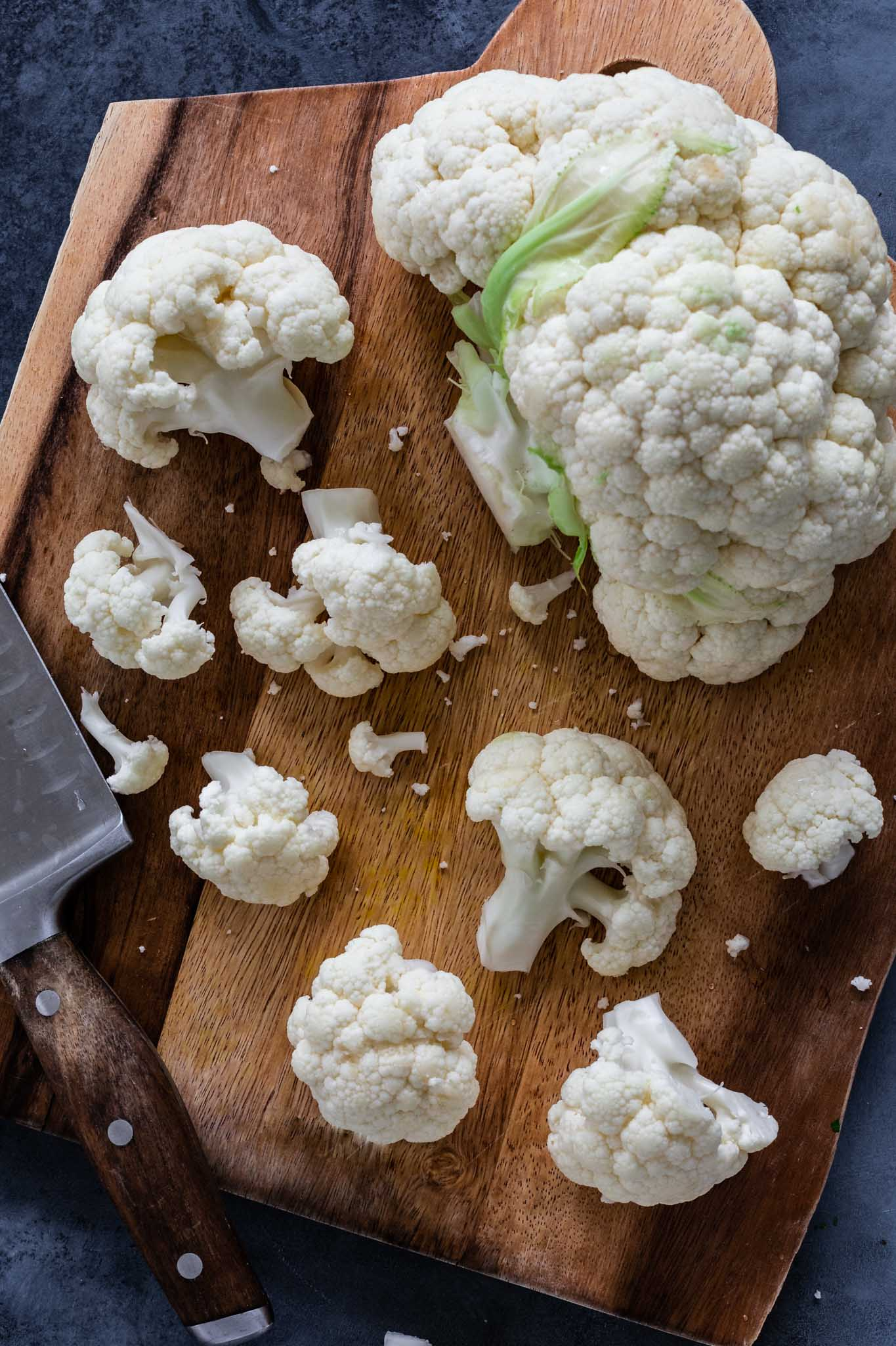 Fresh cauliflower being chopped