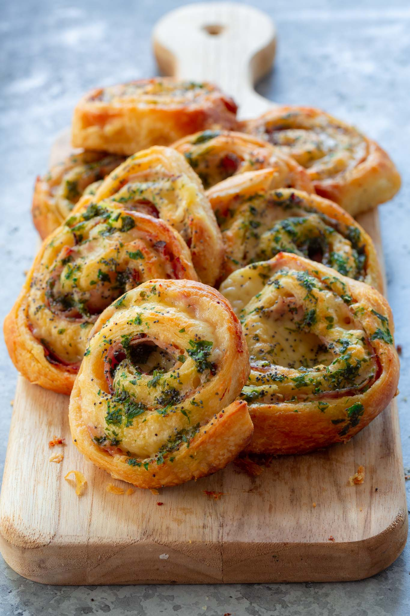Ham and cheese pinwheels on a serving board.